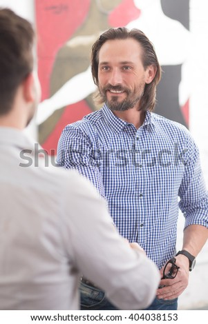 Happy business people having handshaking demonstrating partnership and coworking in office. Entrepreneurs having communication. - stock photo