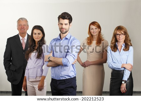 Happy business people standing in office. Business group.  - stock photo