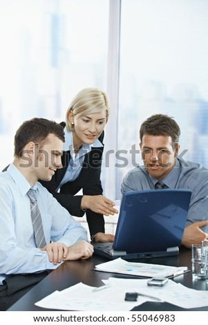 Happy business people talking on meeting at office, smiling, - stock photo