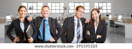Happy Business people team in front of office space with computers - stock photo