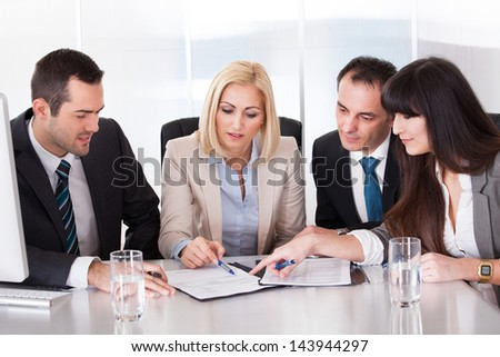 Happy Business Team In Office At The Meeting - stock photo