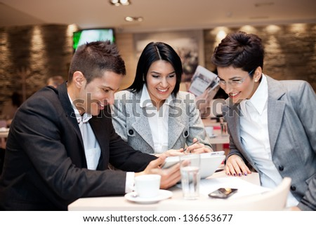 Happy business team relaxed in cafe - stock photo
