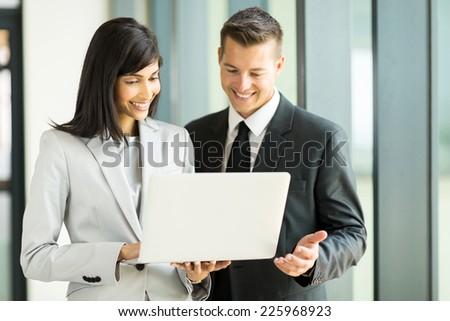 happy business team using laptop - stock photo