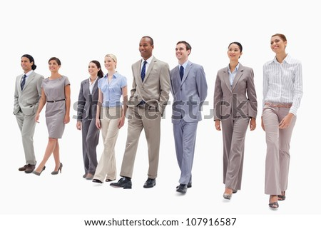 Happy business team walking against white background - stock photo