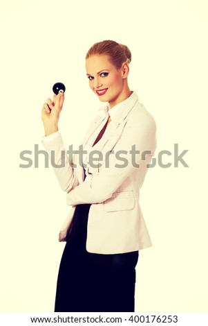 Happy business woman holding eight billiard ball - stock photo