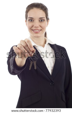 Happy business woman holding keys isolated over white background - stock photo