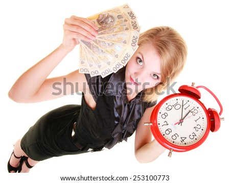 Happy business woman holding red alarm clock and polish currency money banknote. Finance time for investment or savings. - stock photo