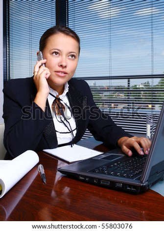 happy business woman in office - stock photo