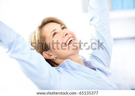 Happy  business woman in the office - stock photo