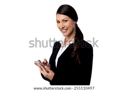 Happy business woman operating her cell phone - stock photo