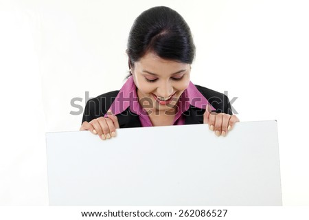 Happy business woman showing blank signboard - stock photo