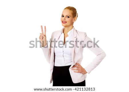 Happy business woman showing victory sign - stock photo