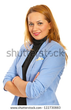 Happy business woman standing with arms folded in semi profile isolated on white background - stock photo