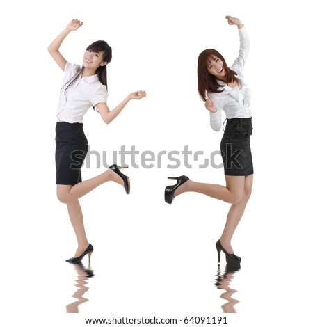 Happy business women dancing over white background. - stock photo