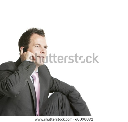 Happy businessman calling on mobile phone, smiling, isolated on white - stock photo