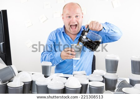 Happy businessman drinks way too much coffee - stock photo