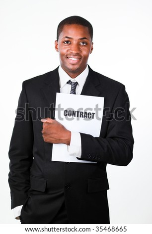 Happy businessman holding a contract and smiling at the camera - stock photo