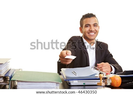 Happy businessman holding an empty business card - stock photo
