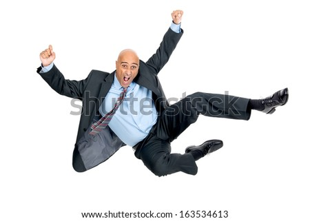 Happy businessman jumping high isolated in white - stock photo