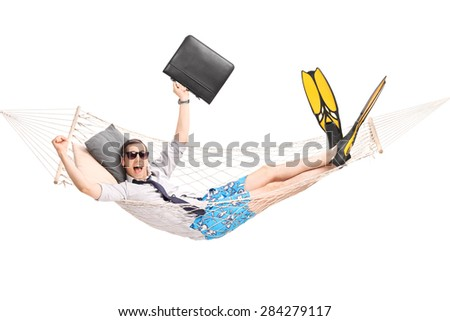 Happy businessman lying in a hammock and gesturing joy with his hands isolated on white background - stock photo