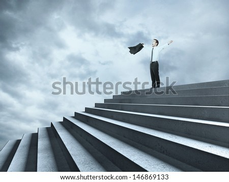 happy businessman near ladder in sky - stock photo