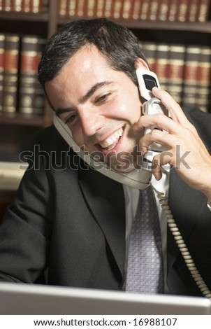 Happy businessman on phone in office. Vertically framed photo. - stock photo