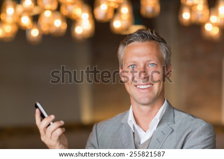 Happy businessman on the phone at the cafe - stock photo
