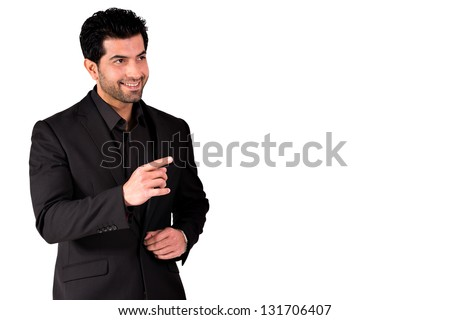 happy businessman pointing at copy space - stock photo