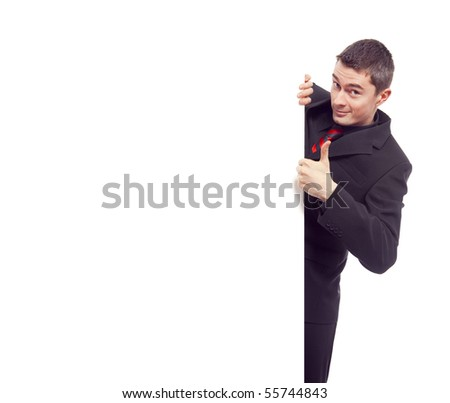 happy businessman pointing to white blank card - stock photo