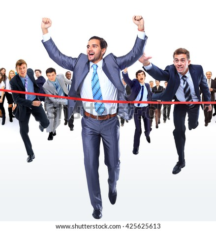 Happy businessman running through finishing line - stock photo