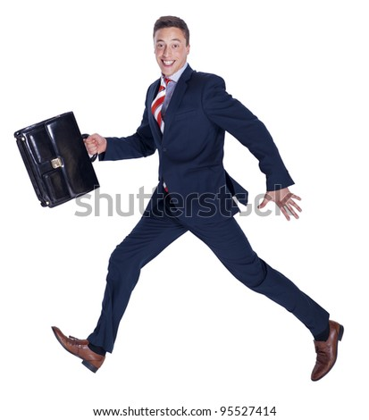 Happy businessman running with a briefcase - stock photo