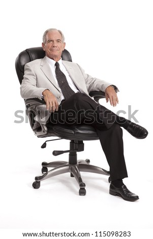 Happy Businessman sitting in chair - stock photo
