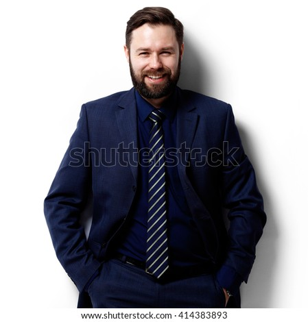 Happy businessman standing isolated on white - stock photo