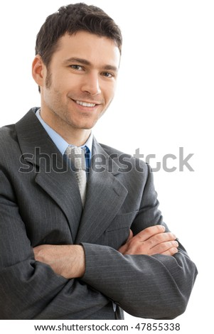 Happy businessman standing looking at camera, smiling. Isolated on white background. - stock photo