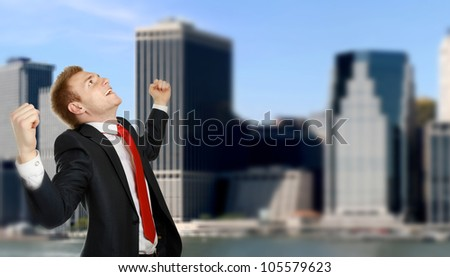 Happy businessman standing  over a cityscape - stock photo
