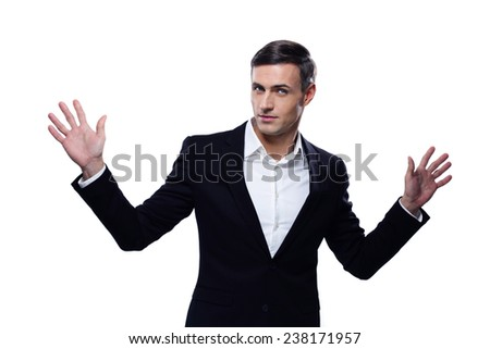 Happy businessman standing with hands on the sides - stock photo