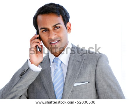 Happy businessman taking a phone call in  the office - stock photo
