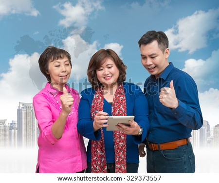 Happy Businessman Teamwork on Office building with blue sky background, business concept - stock photo