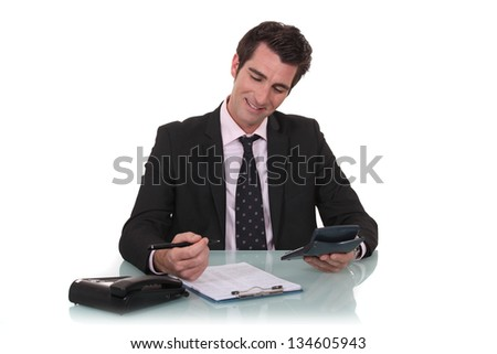 Happy businessman with a calculator - stock photo