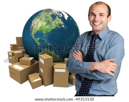 Happy businessman with a world map and a pile of  packages on the background - stock photo