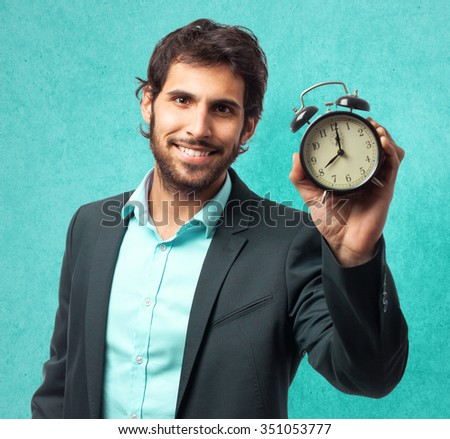 happy businessman with clock - stock photo