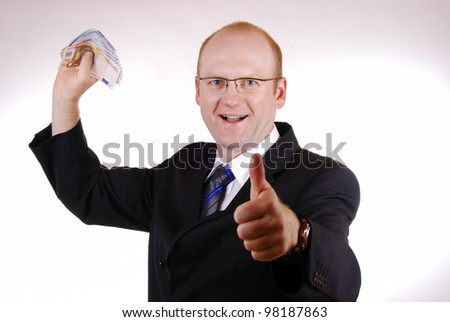 happy businessman with euro bills - stock photo