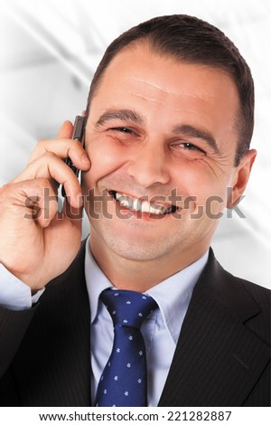 Happy businessman with suit speaking on telephone. Isolated Work Path - stock photo