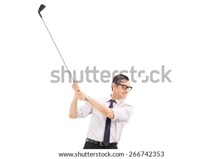 Happy businessman with tie trying to shoot a golf ball isolated on white background - stock photo