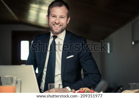 Happy businessman working at home - stock photo