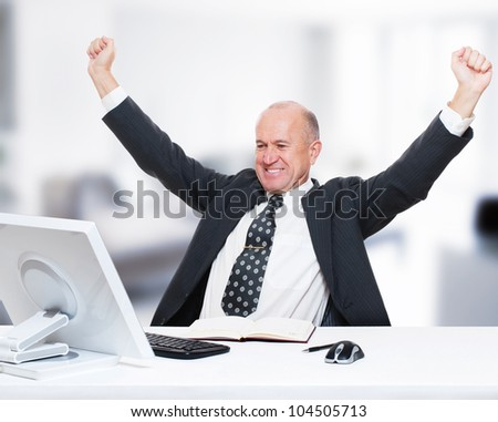 happy businessman working in his office - stock photo