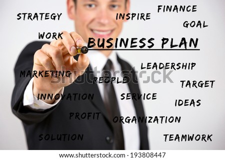Happy businessman writing business keywords with marker on screen. - stock photo