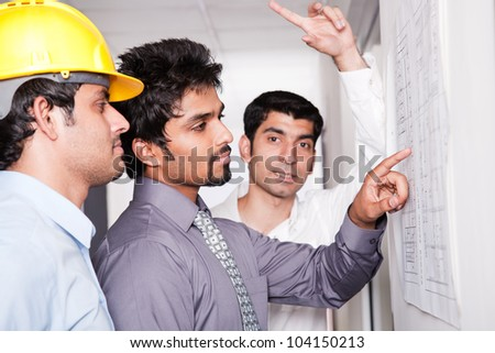 happy businessmen in a meeting with architect - stock photo