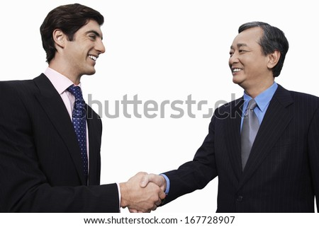 Happy businessmen shaking hands over white background - stock photo