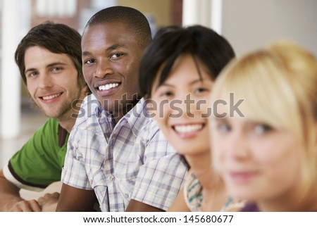 Happy businessmen with female colleagues in meeting room - stock photo